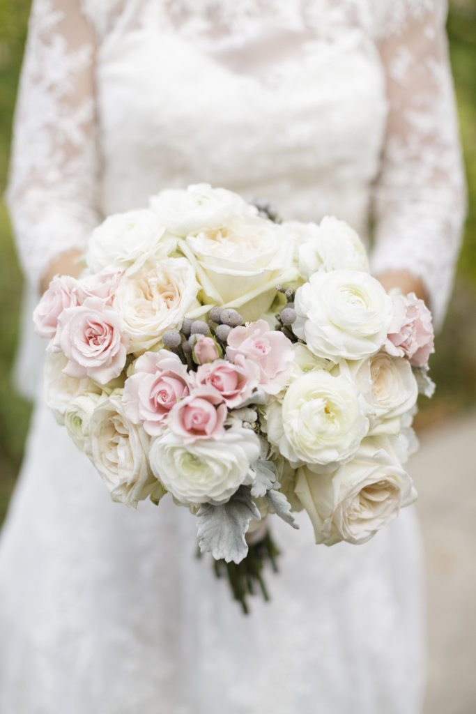 bride with white ivory blush bouquet