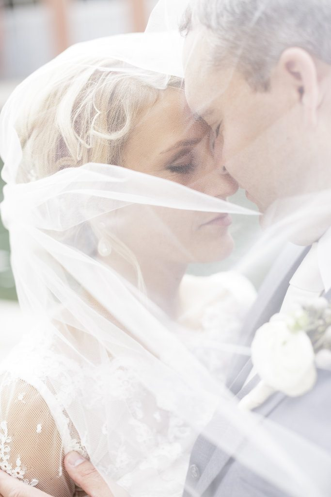 bride and groom veil picture