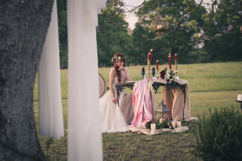 bride sitting at whimsical table