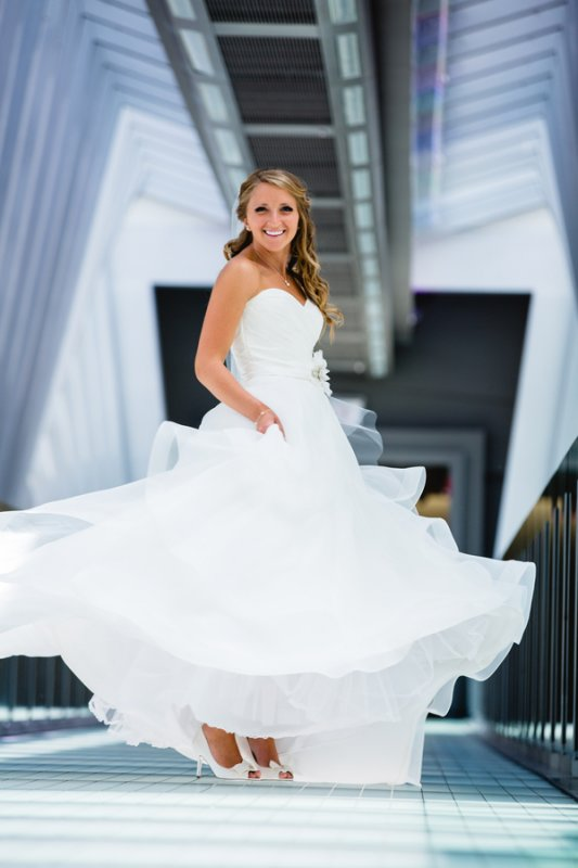bride twirling in her gown