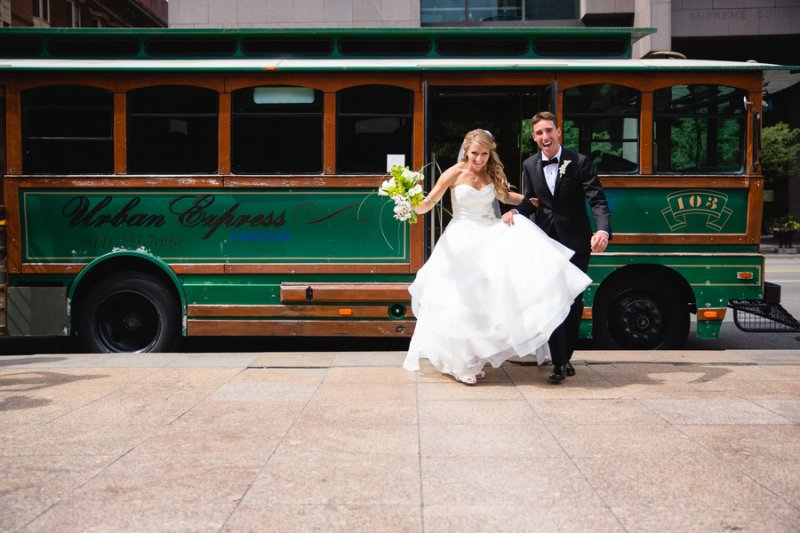 bride and groom getting off trolley