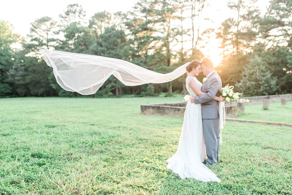 bride veil blowing in wind sunset