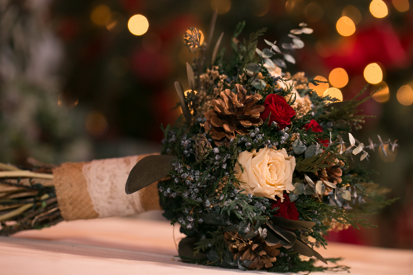 red and white rose bouquet with pine cones Christmas Wedding Ideas In December