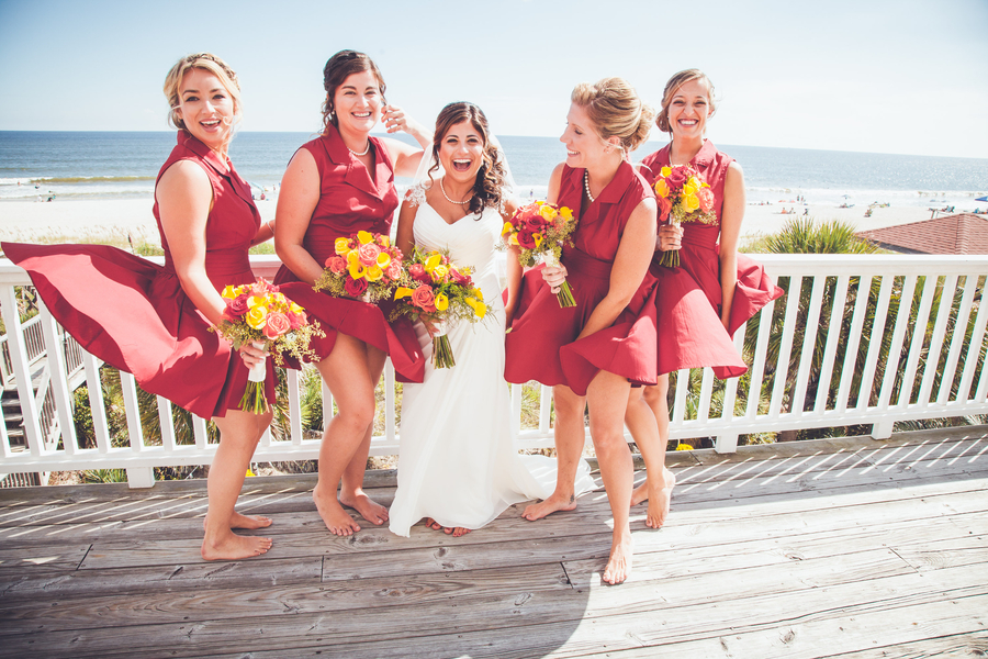 bridesmaids with short red dress