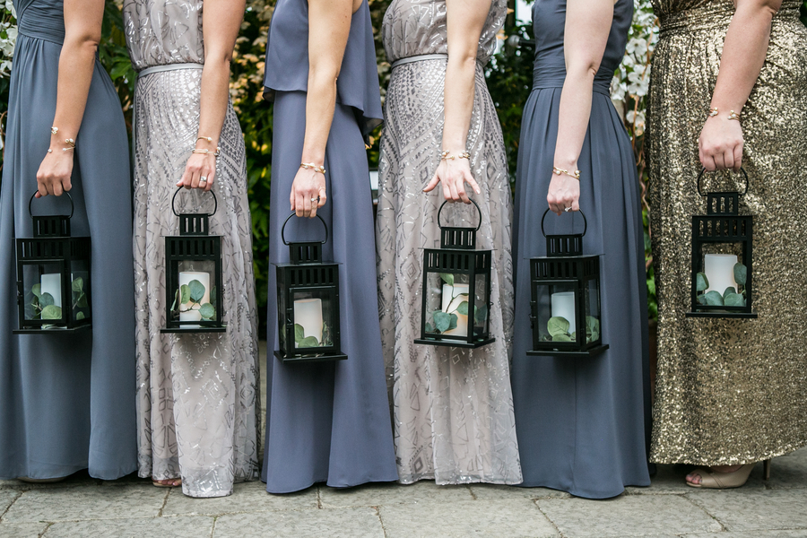bridesmaids holding lanterns
