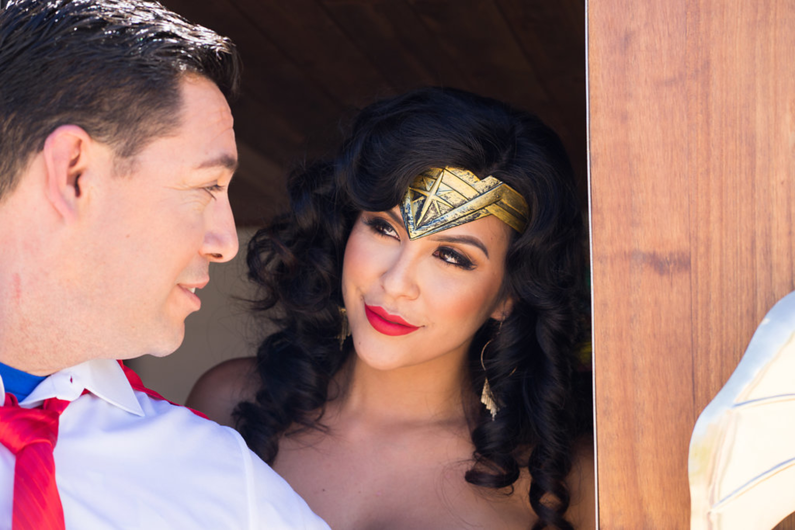 Superman and Wonder-woman smiling at each other