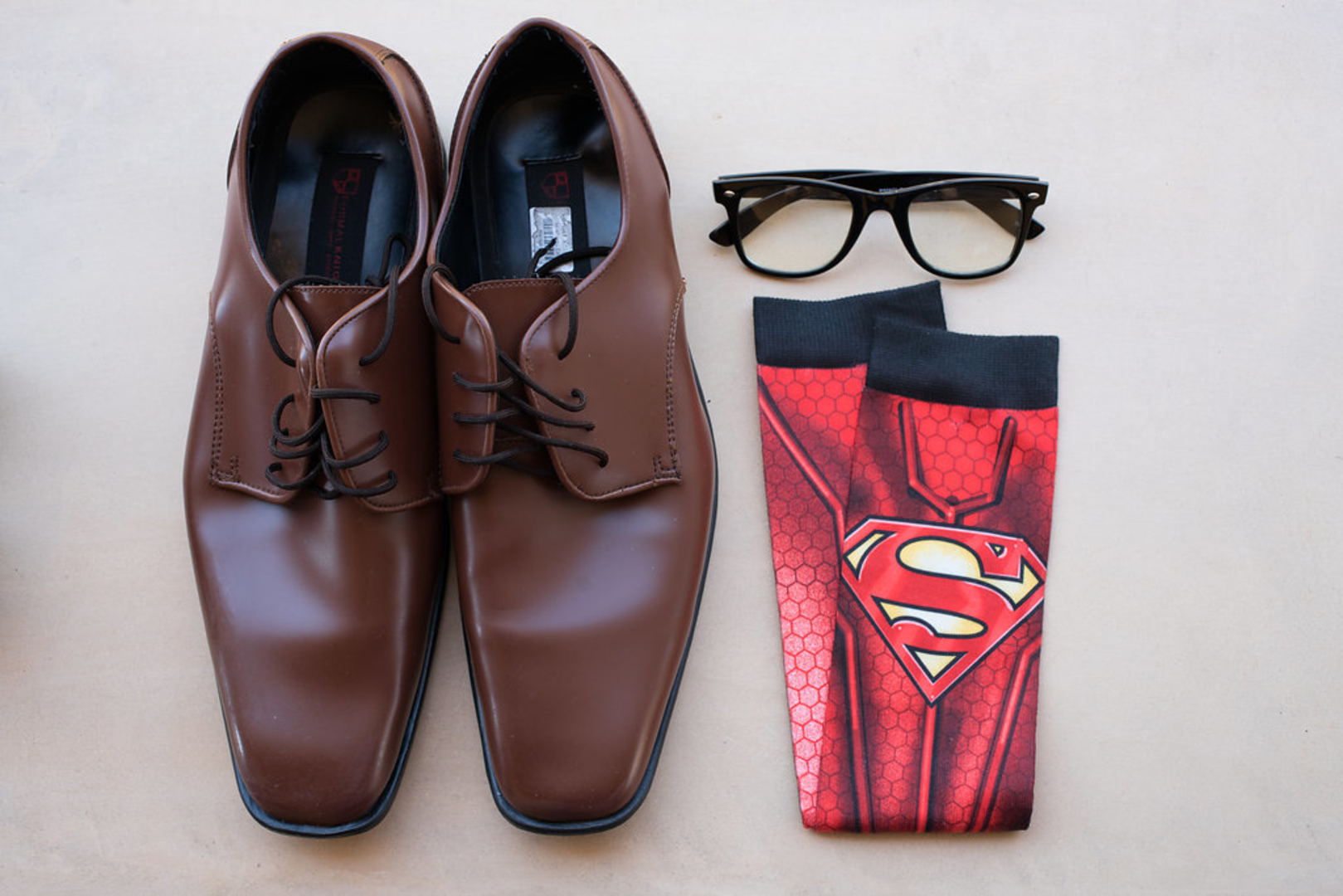 Superman groom's socks with brown shoes and Clark Kent Glasses