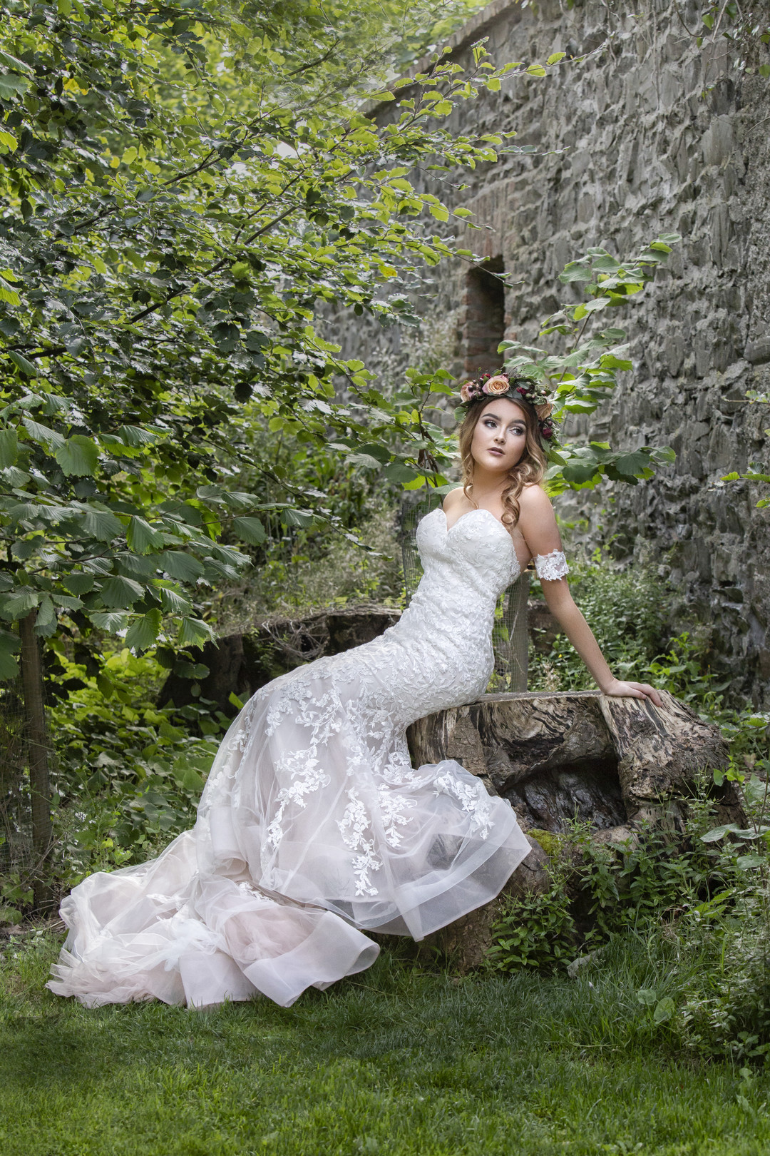 Bride sitting in front of an Ireland castle
