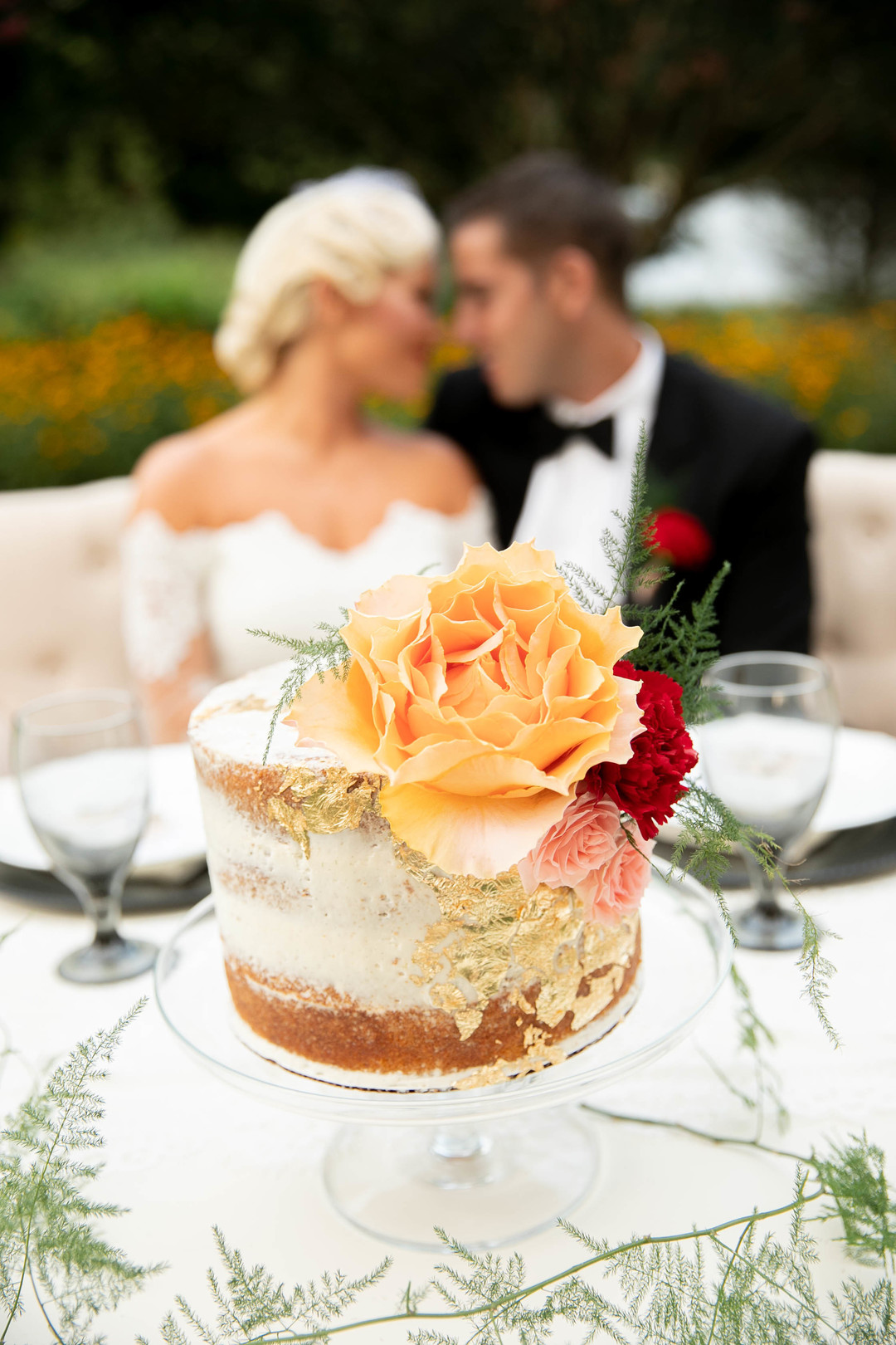 naked cake with gold foil frosting
