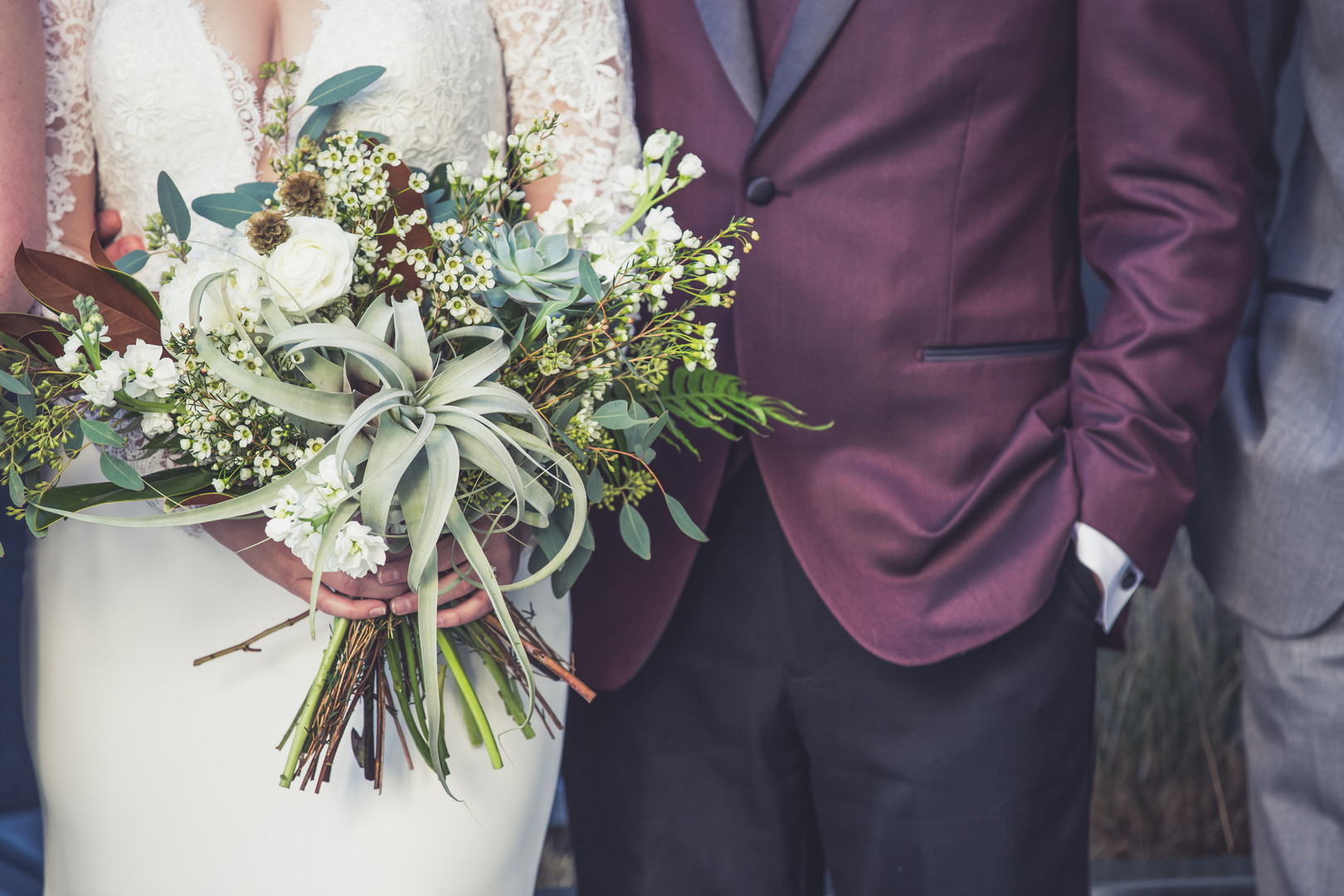 groom with burgundy suit