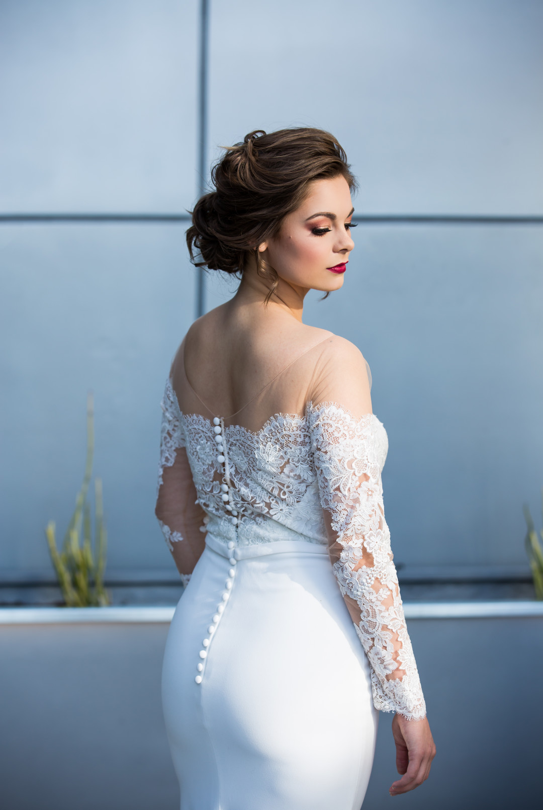 fitted wedding dress with lace and back buttons