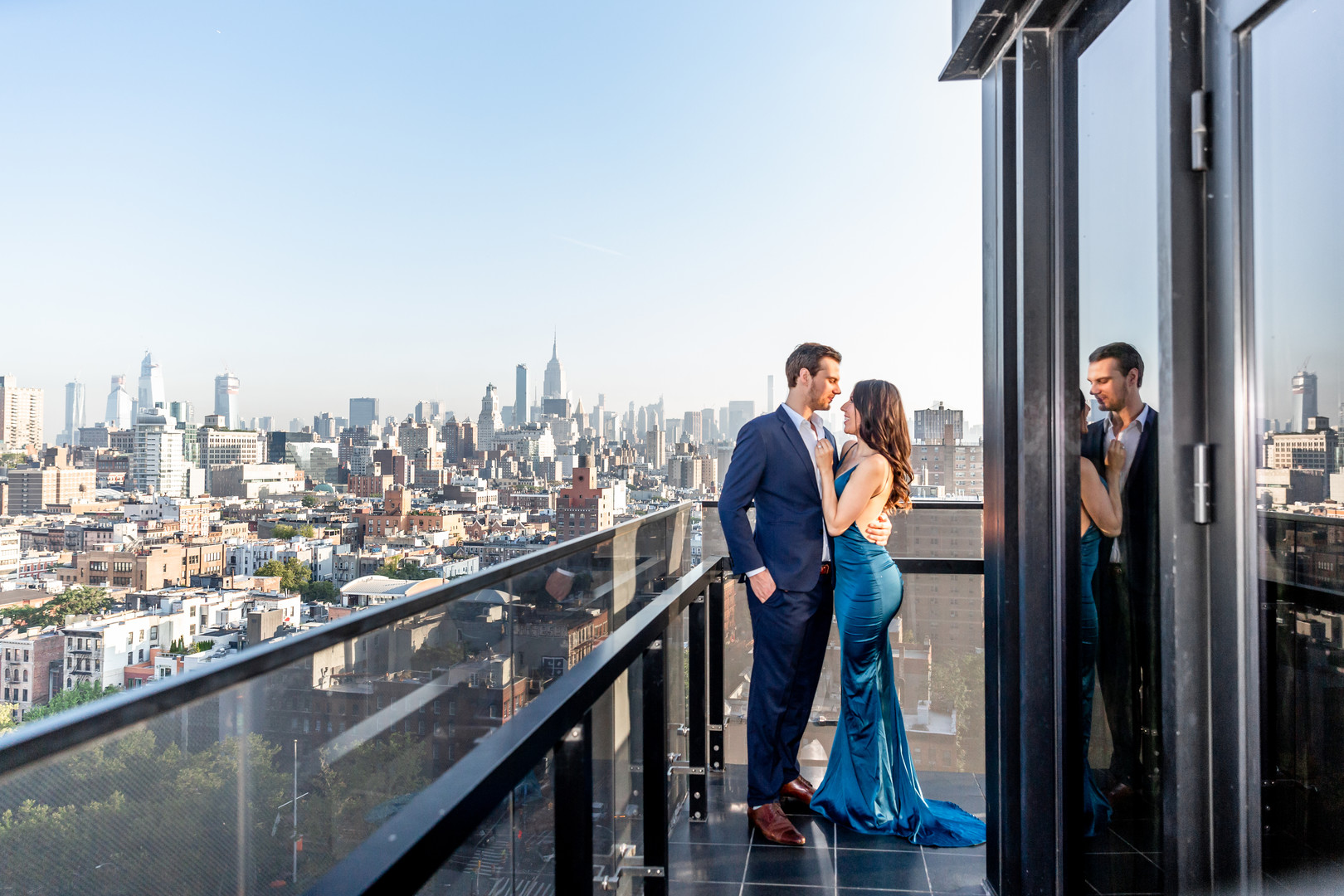 engagement photo with city skyline backdrop
