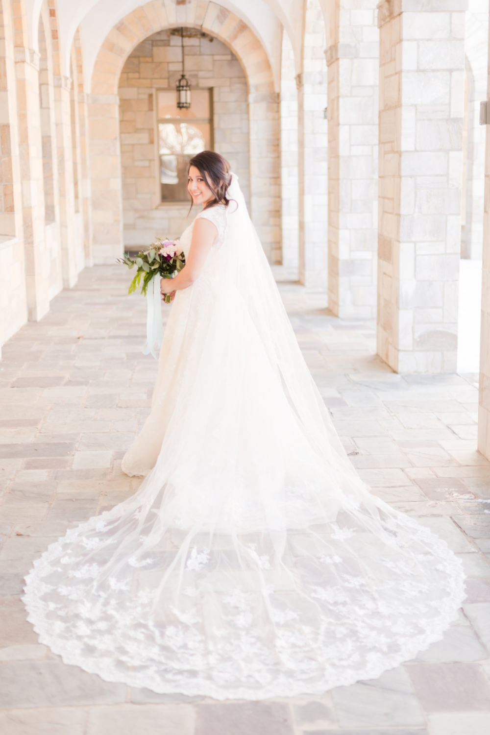 bride in stone church hallway
