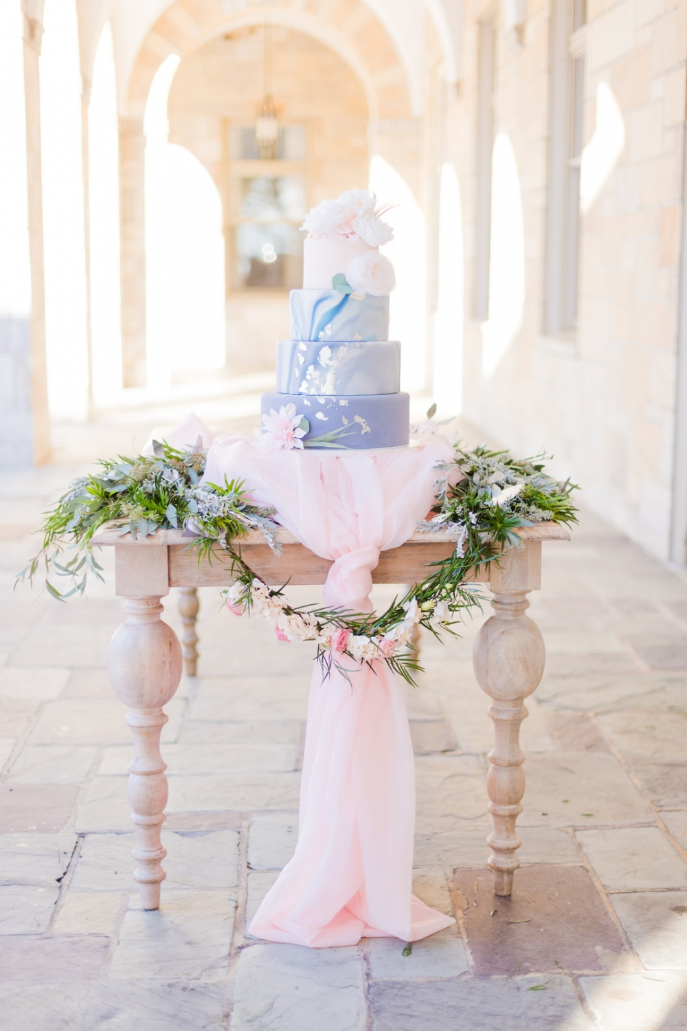 pastel wedding cake on a decorated table