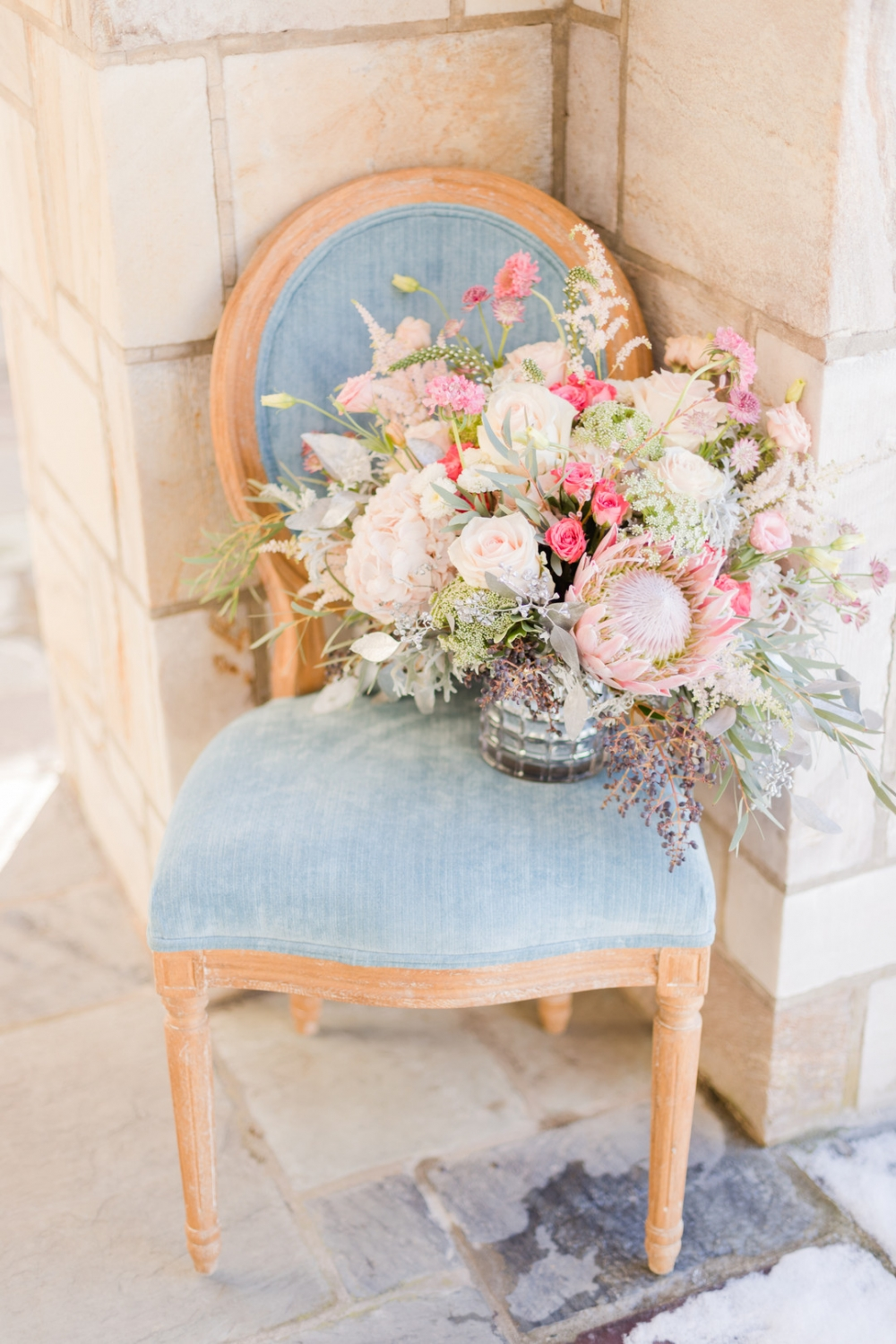 pastel wedding bouquet on a light blue chair