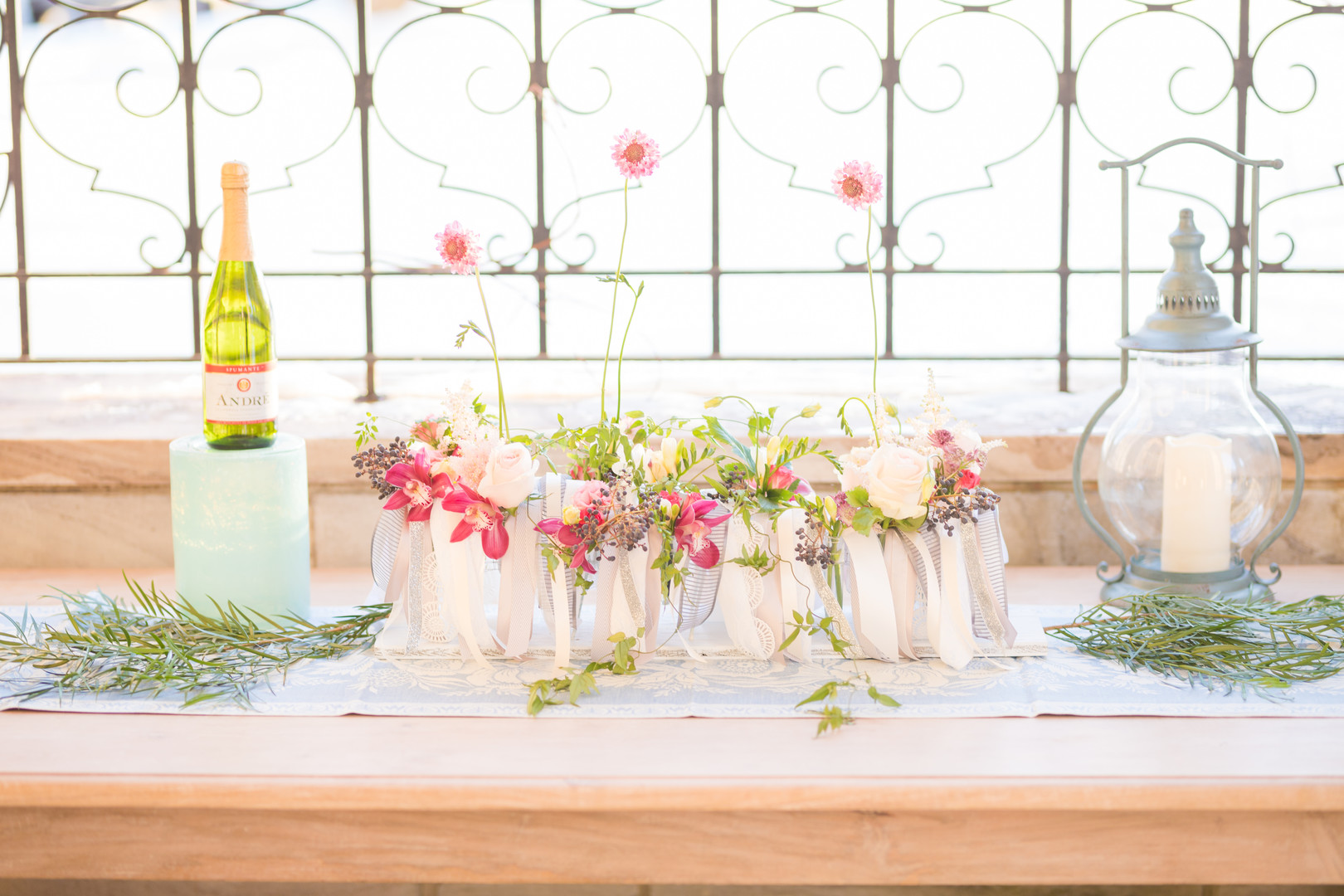 DIY centerpiece idea with ribbon and flowers in glasses