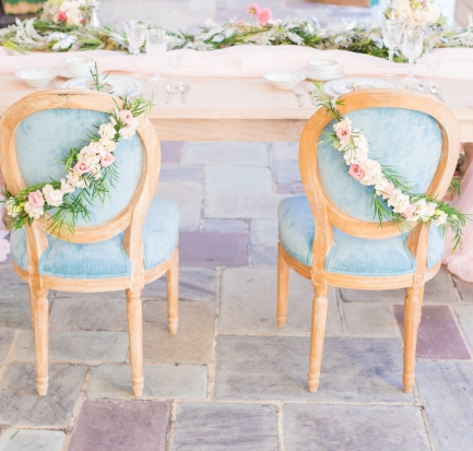 dusty blue and pink wedding, light blue chairs with floral and greenery sash