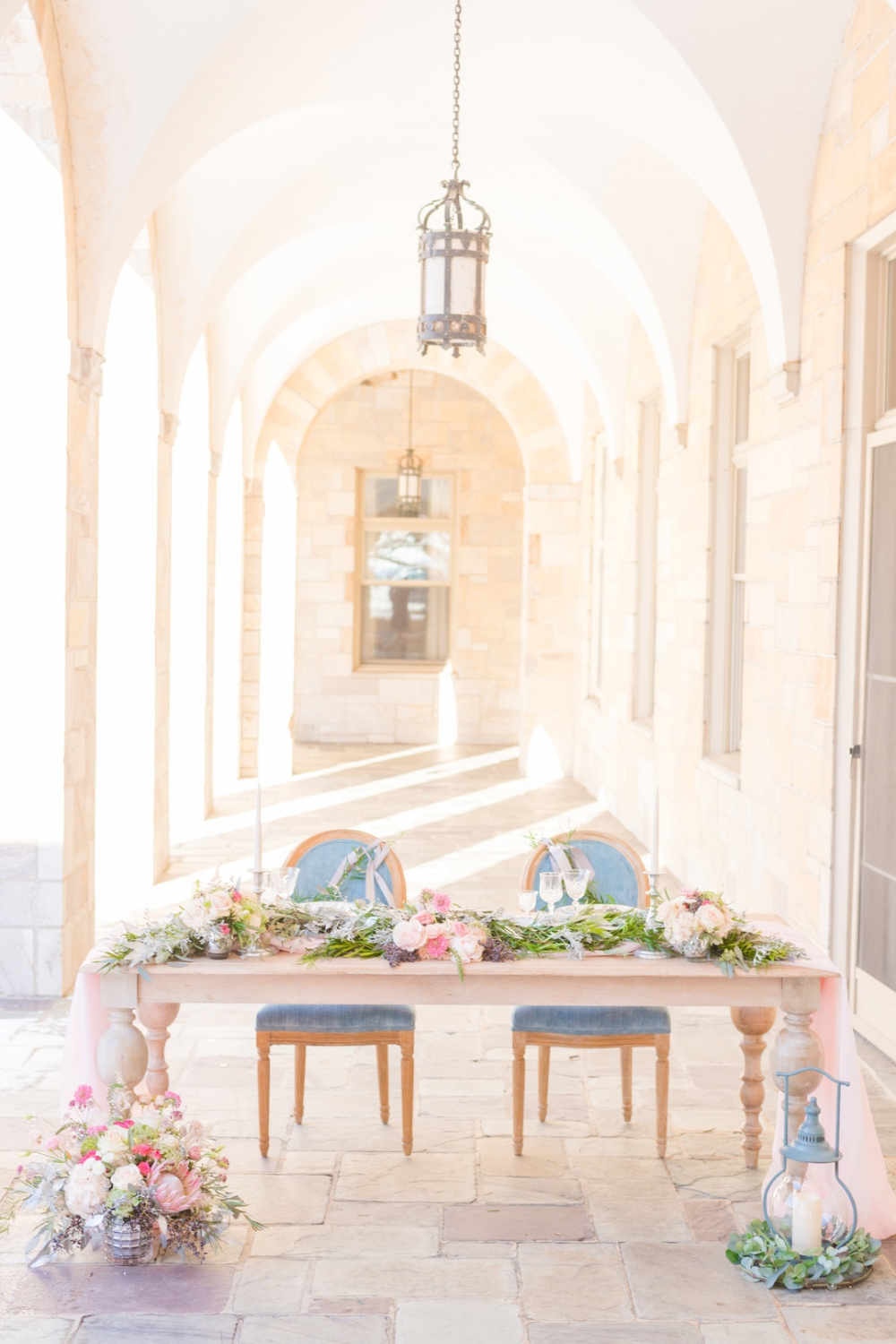 light blue and floral sweetheart table