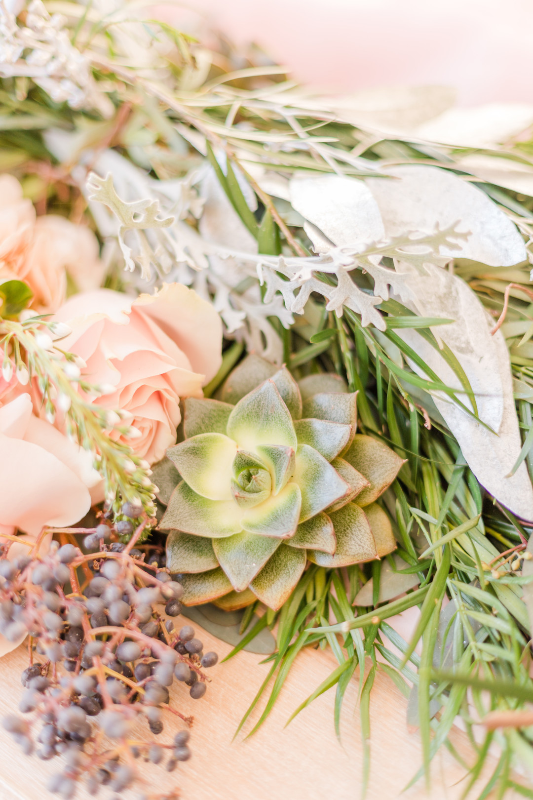 succuslents, light pink roses and greenery