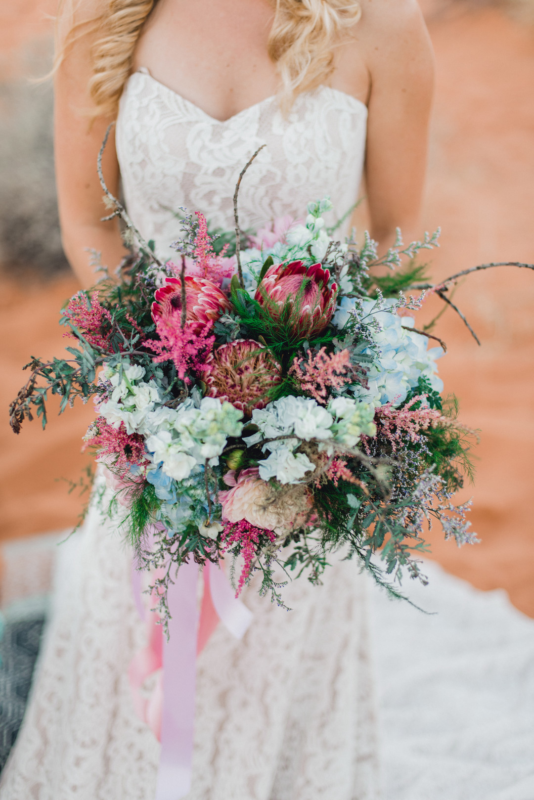 teal blue hydrangea and pink flower bouquet
