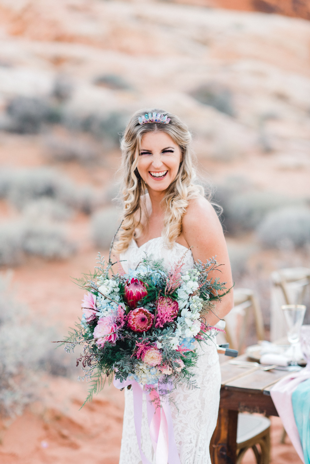 pretty bride in dessert, bride holding pink bouquet