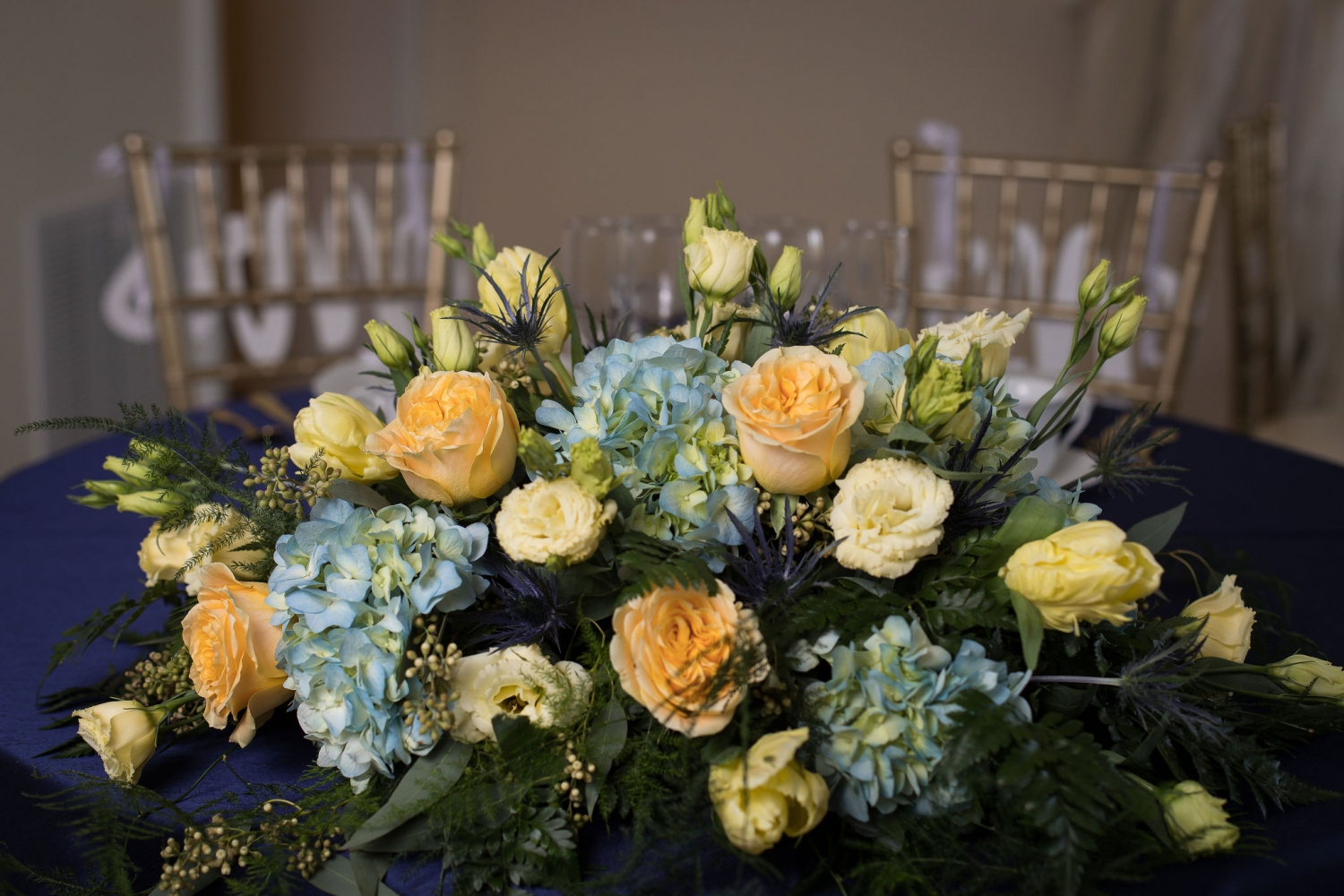 yellow and blue floral centerpiece