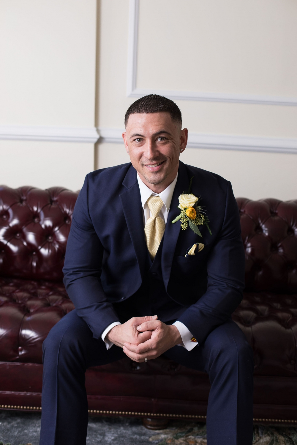 groom with yellow boutonniere