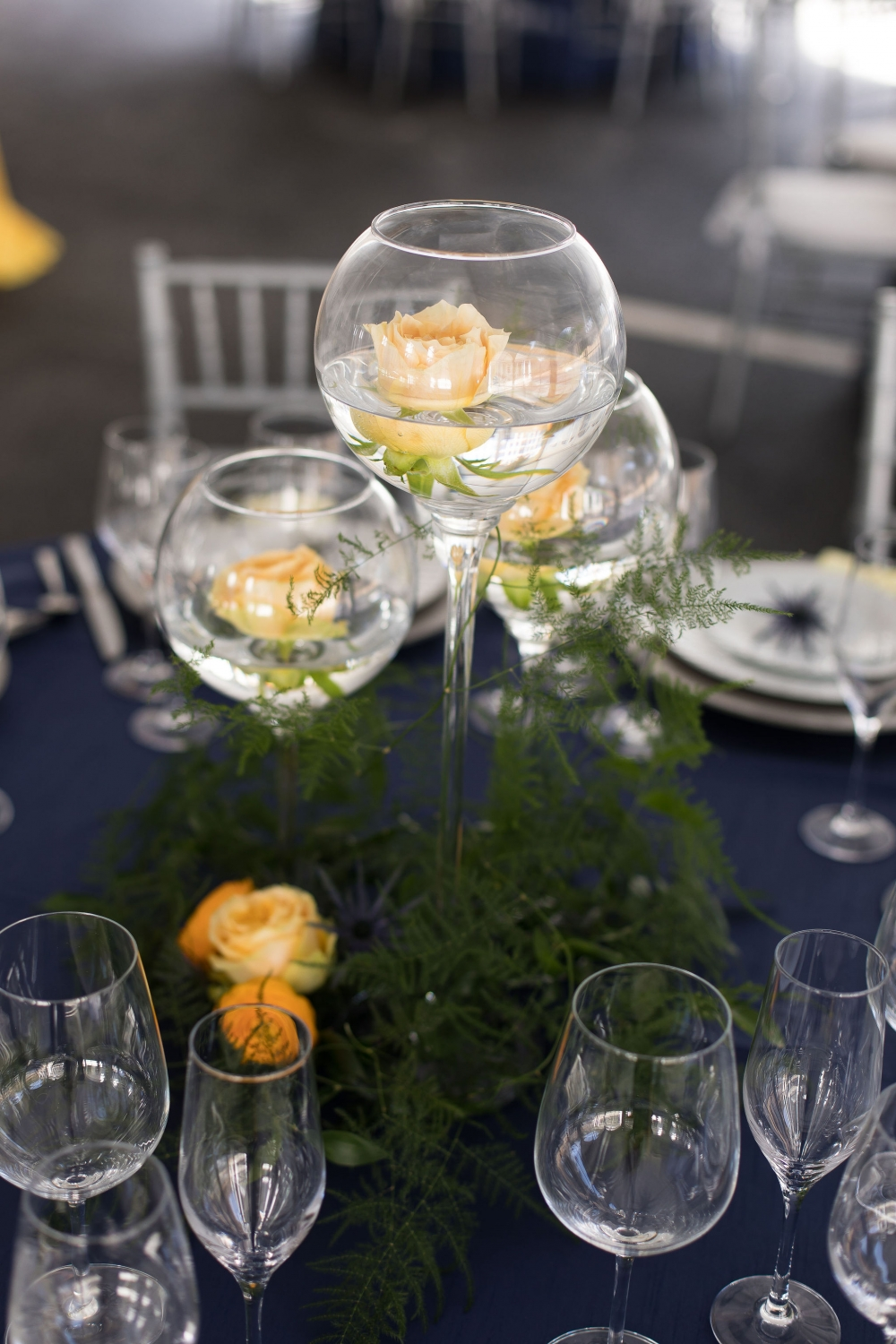 floating flower centerpiece in tall glass