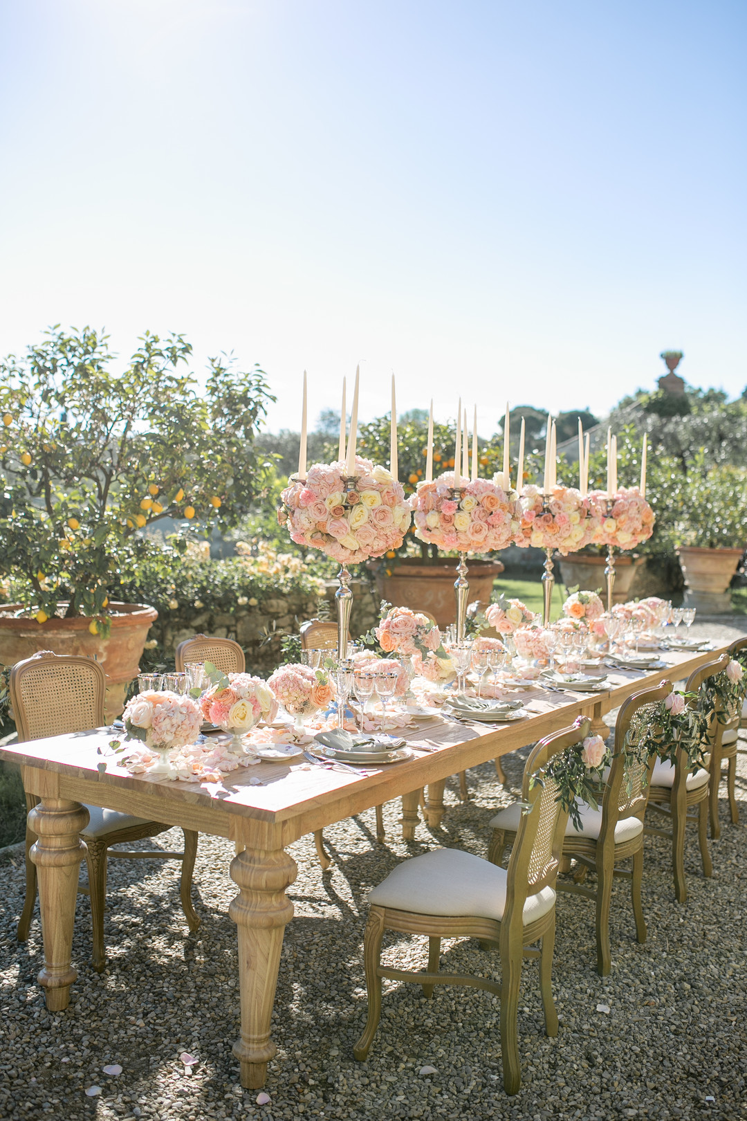 pink, blush, peach and light yellow rose centerpieces with candles
