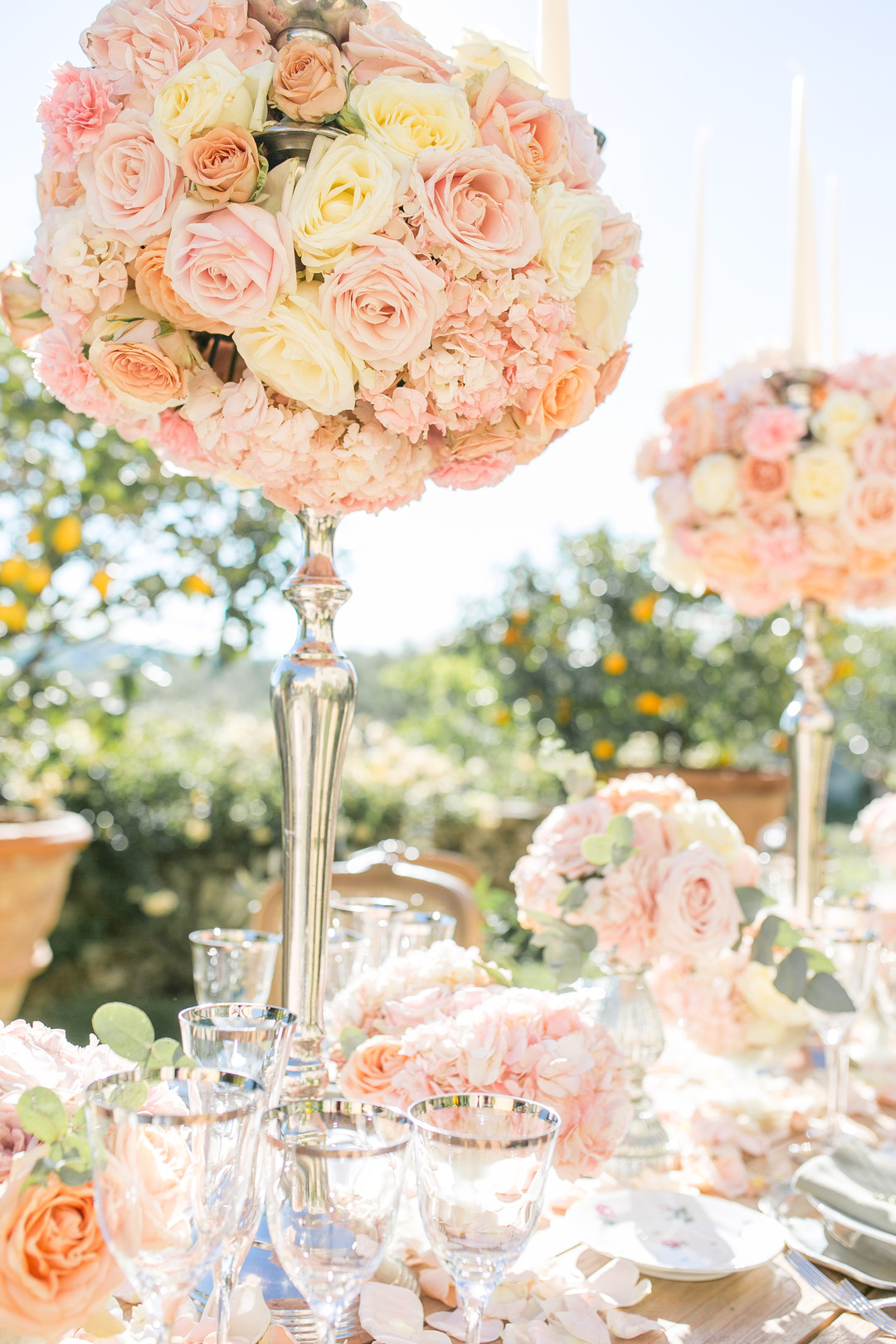 pink, blush, peach and light yellow rose centerpieces on a silver candelabra