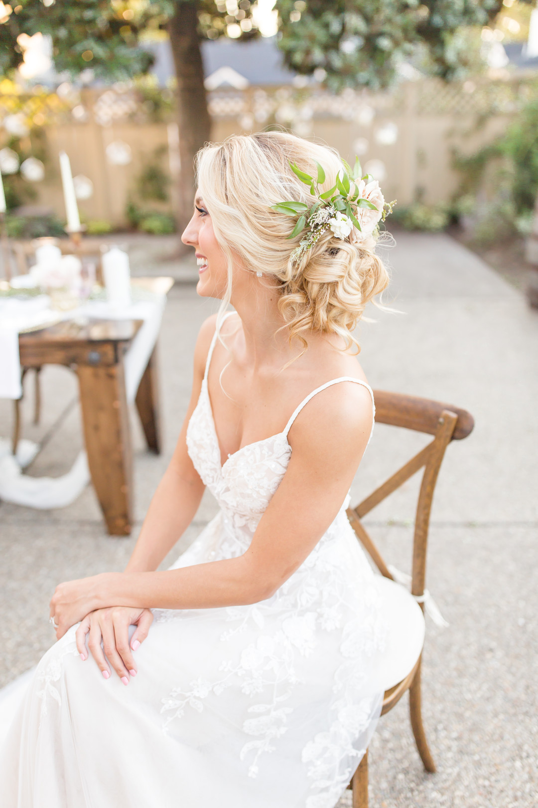 textured bride updo with flowers hairstyle