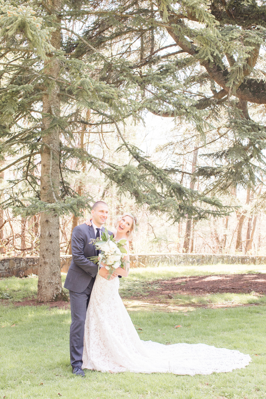 Bride and groom outdoor photo in front of large tree