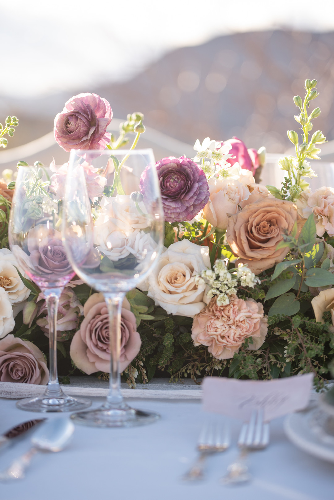 garden roses on table with wine glasses