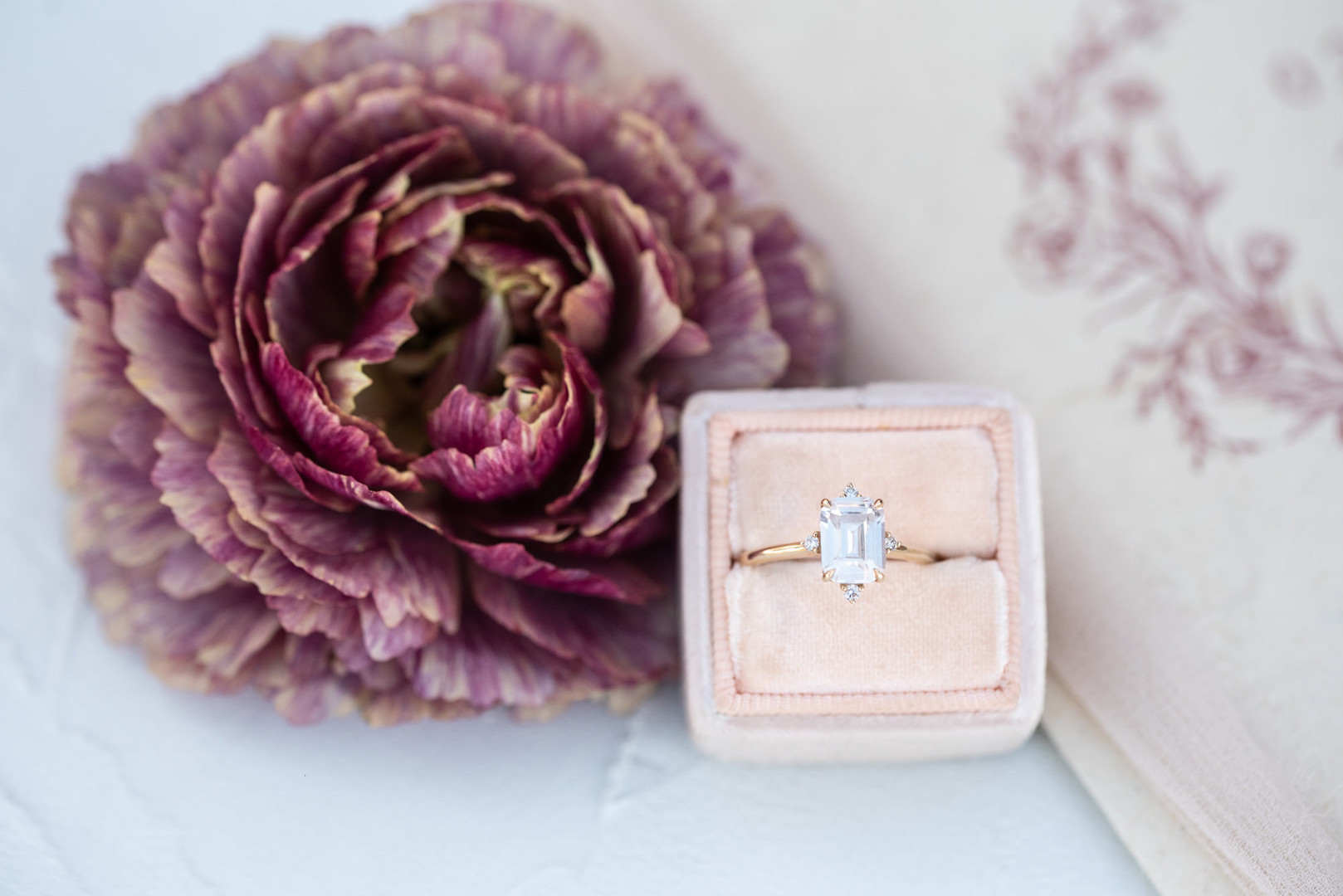 Engagement ring in blush ring box.