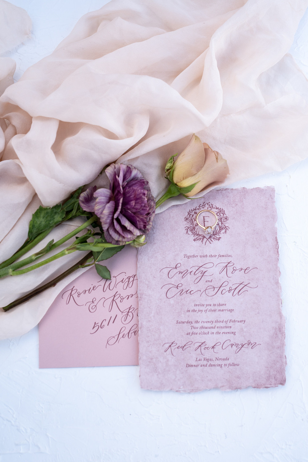 Calligraphy invitation on purple parchment paper
