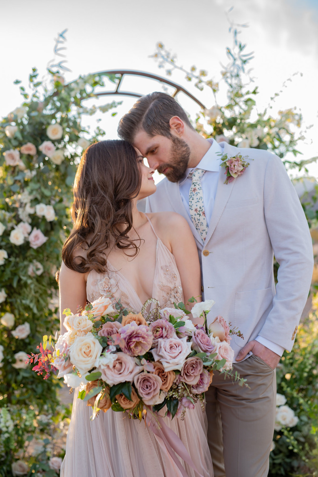 Gorgeous Bride and Groom with floral backdrop