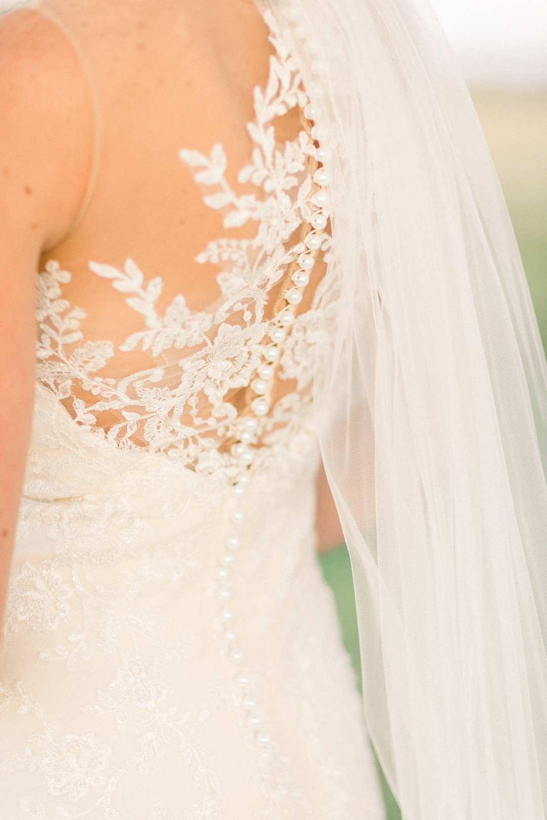elegant lace backed wedding gown