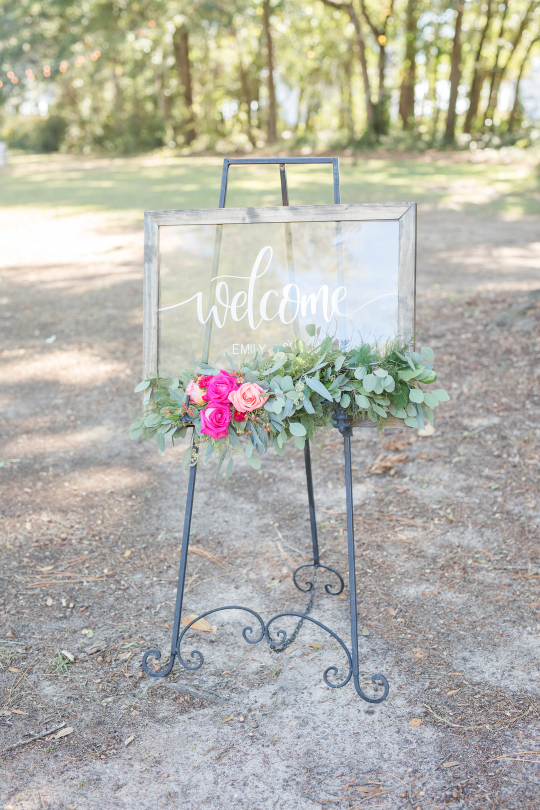 welcome sign with bright pink flowers