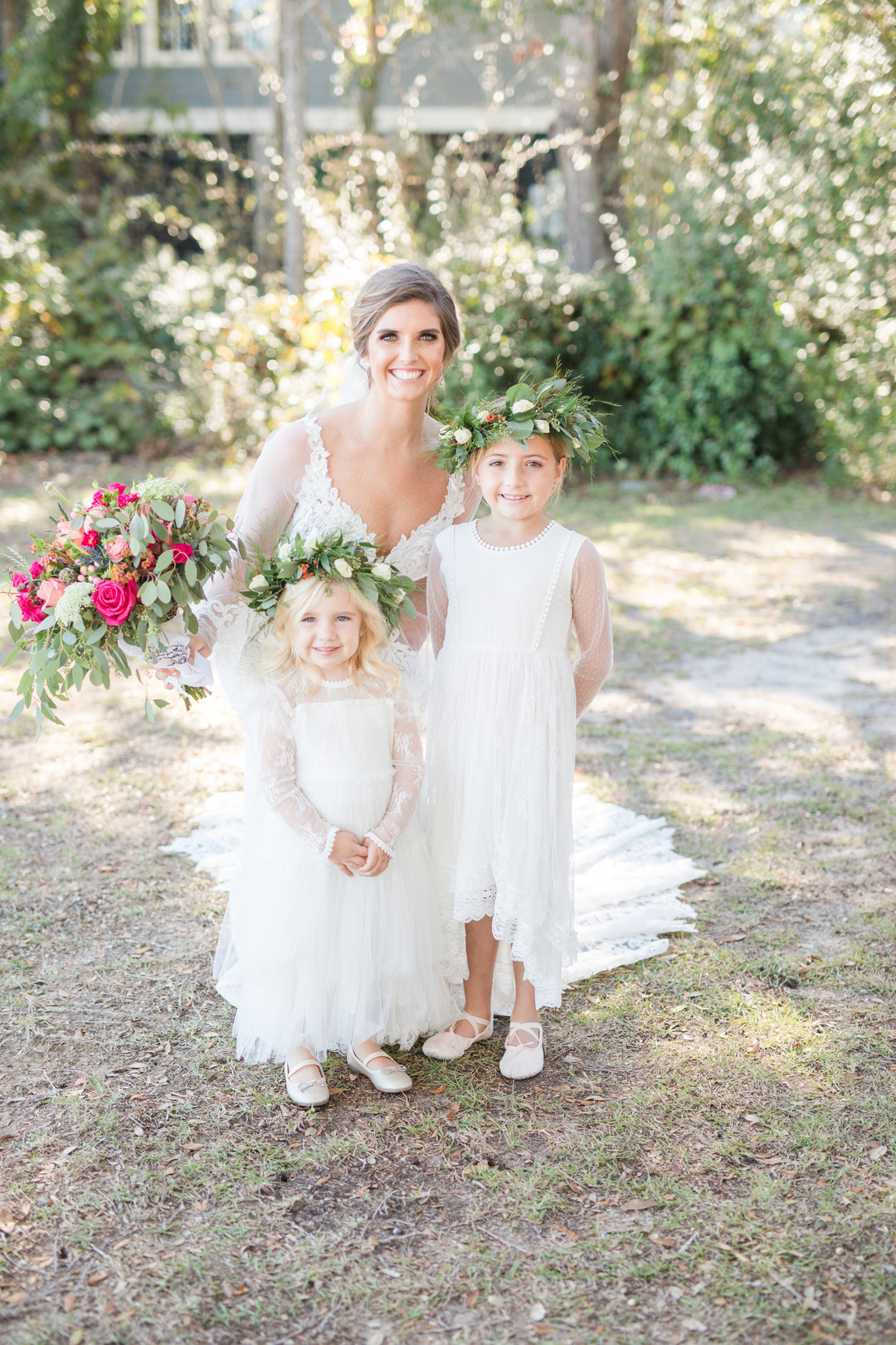 bride with flower girls wearing flower crowns