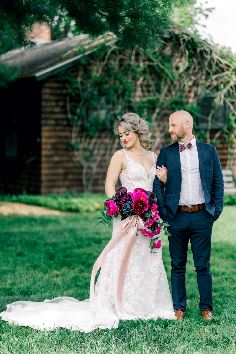 bride and groom with vibrant colored bouquet