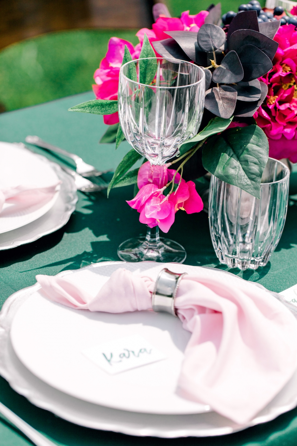 place setting with light pink napkin