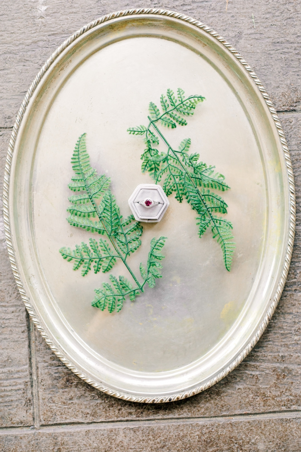 ring photo inspiration on a metallic platter with a pretty ring box and greenery