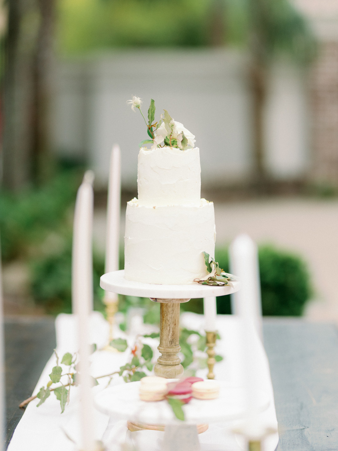 simple white wedding cake with greenery