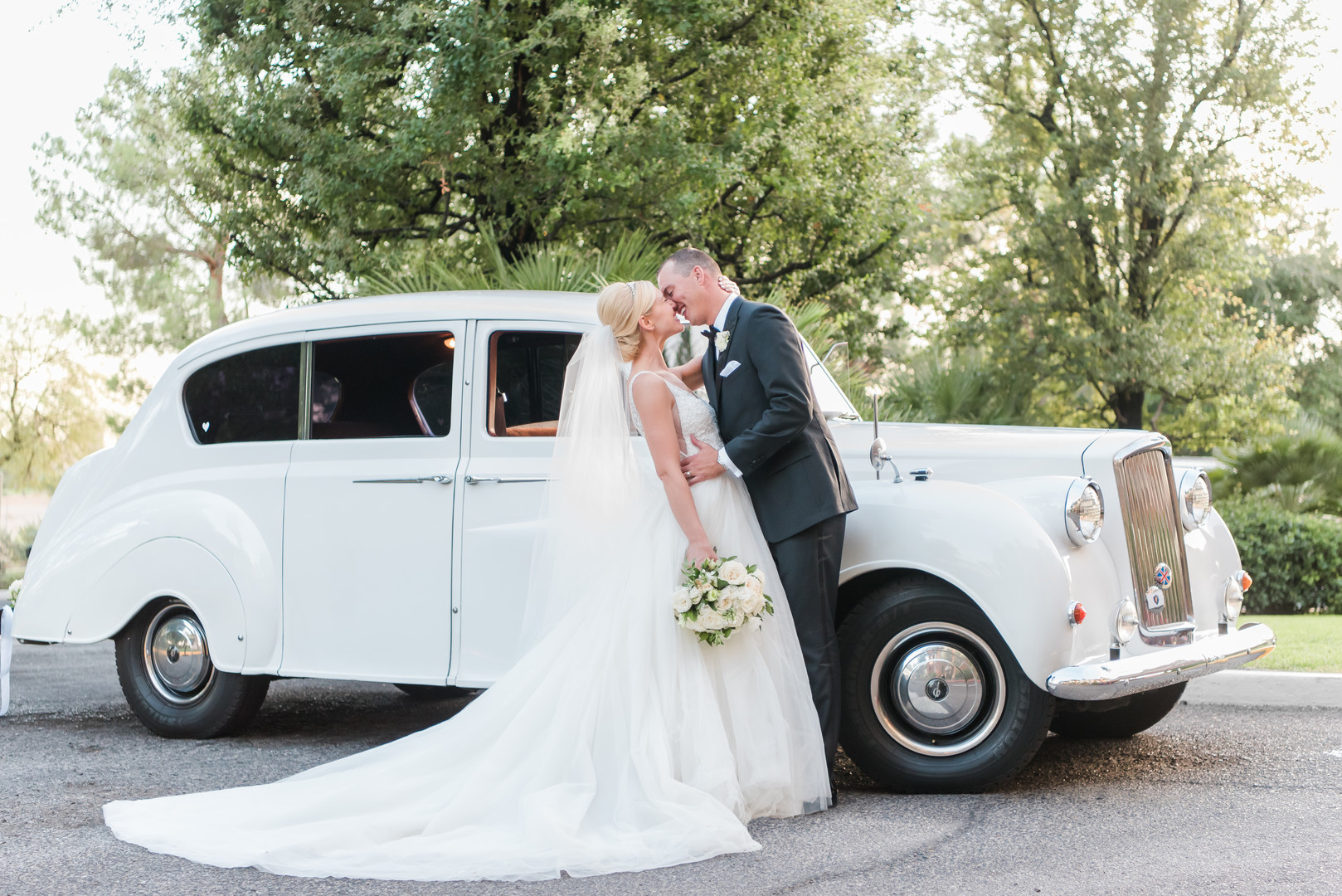 bride and groom vintage car multi-faith las vegas wedding