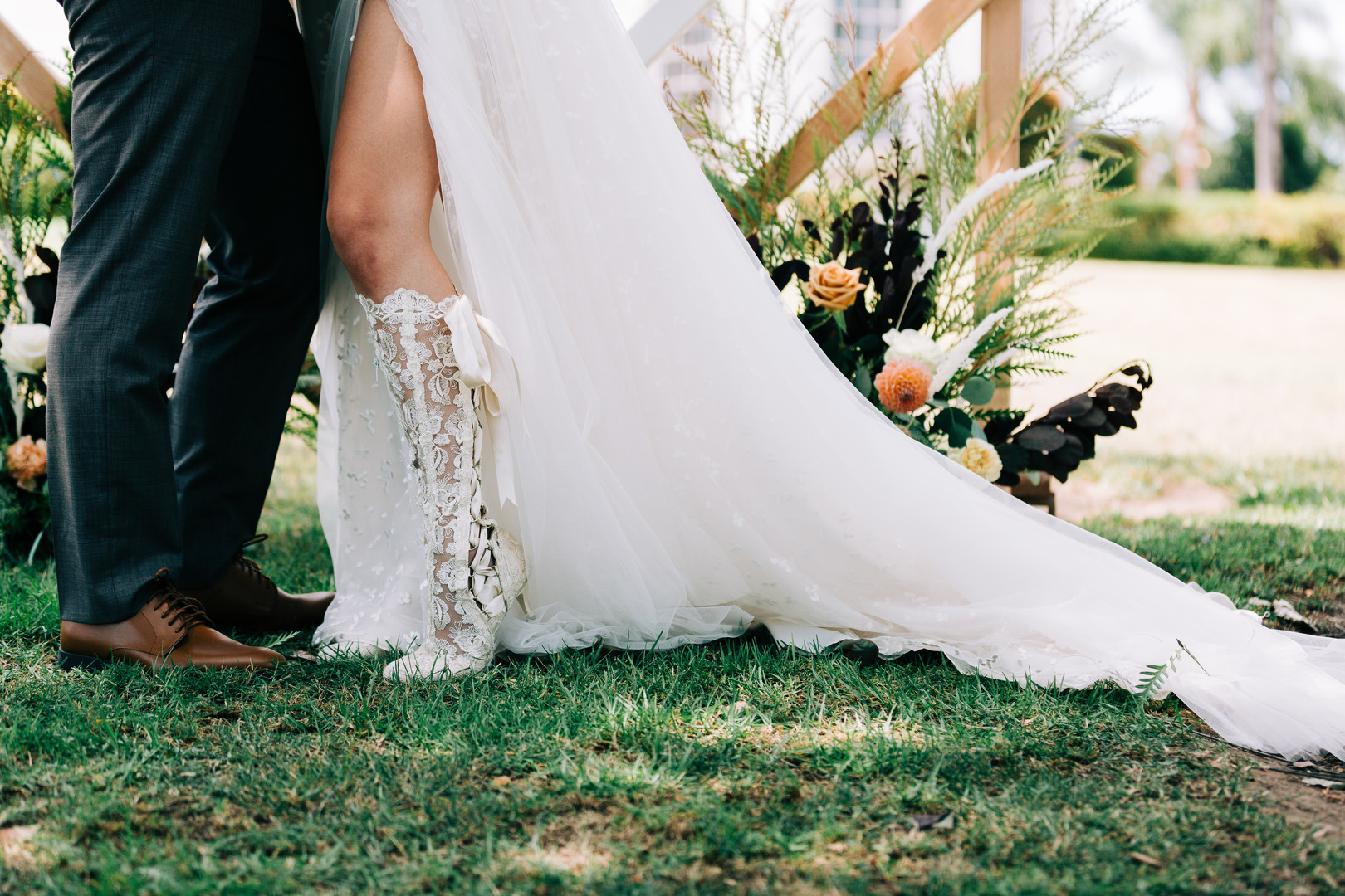 bride and grooms' shoes with boho flare