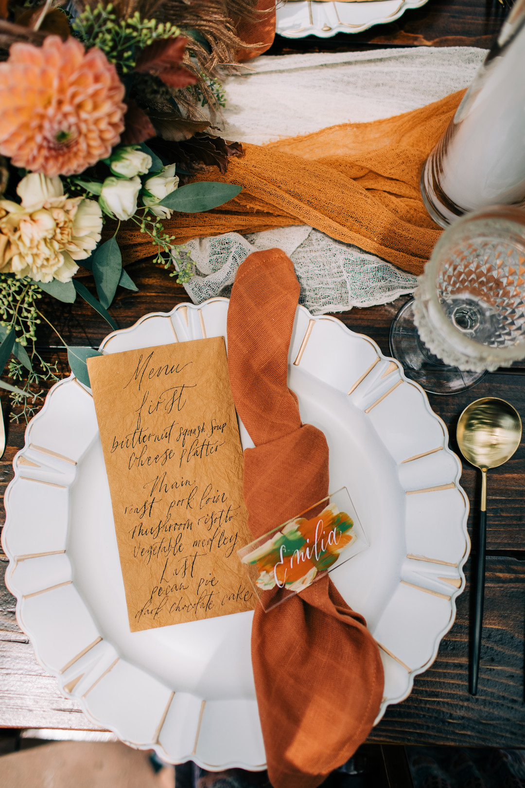 orange hued wedding table setting for fall