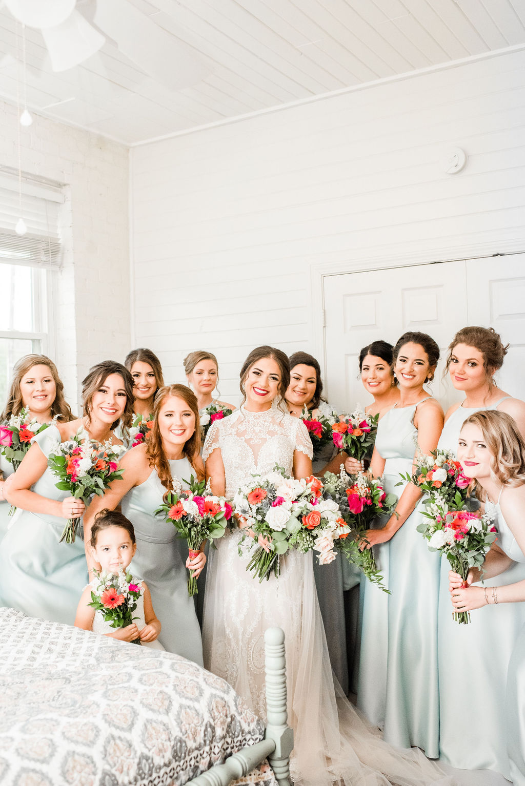 bridal party with light blue dresses and colorful bouquets