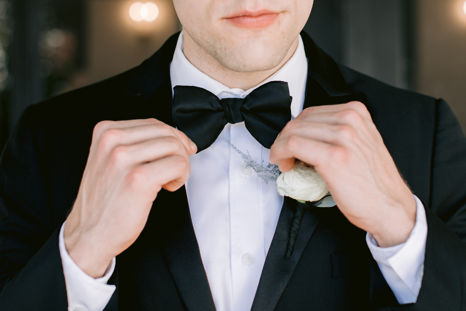 Il Mercato Wedding, New Orleans Wedding, Magazine Street Wedding, groom adjusting bow tie, groom portrait ideas