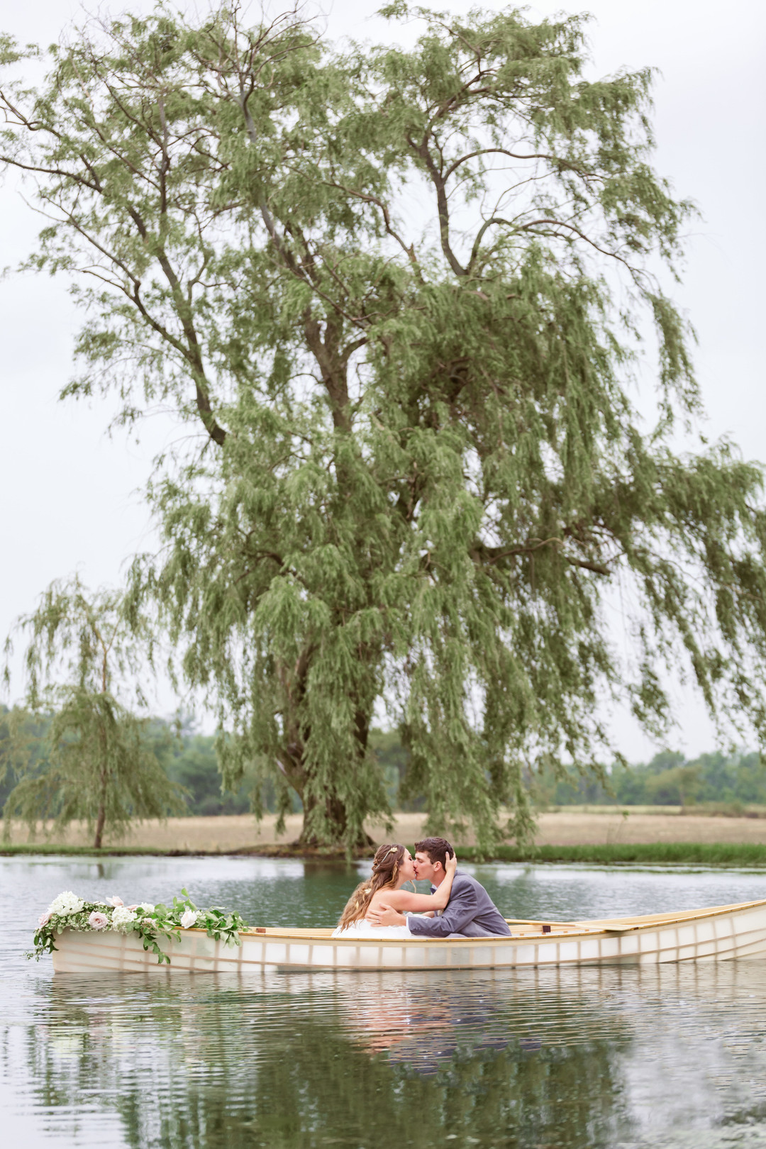 French Hen Farm, Blush Wedding, Ohio Wedding, bride and groom in canoe on lake