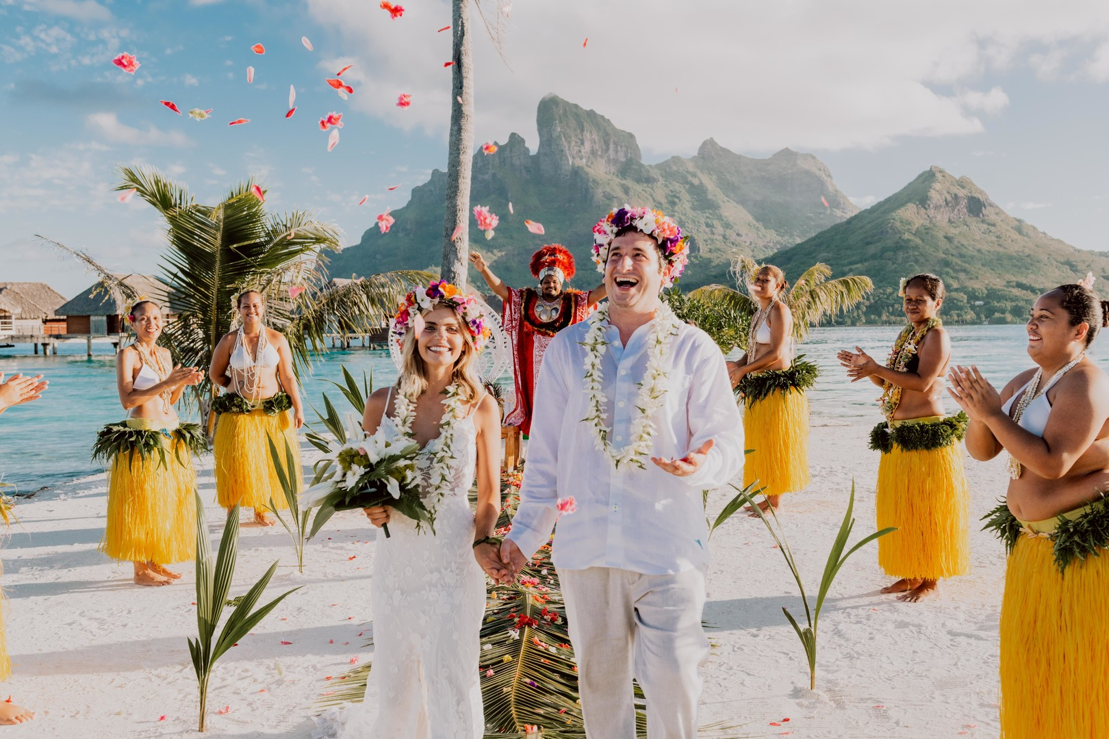 Wedded couple in Bora Bora happy with petals in the air